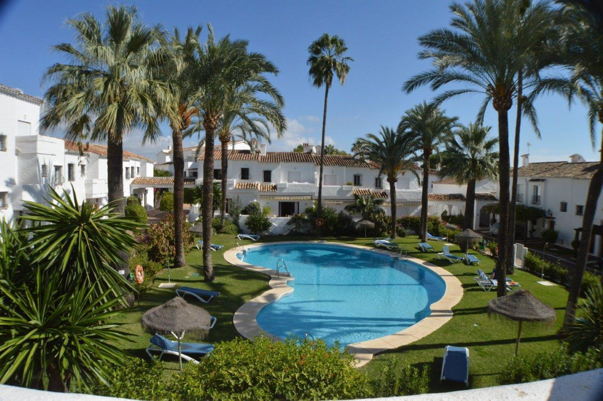 A beautiful two bedroom townhouse overlooking the pool in the centre of Golf Valley. Los Naranjos Co,Spain