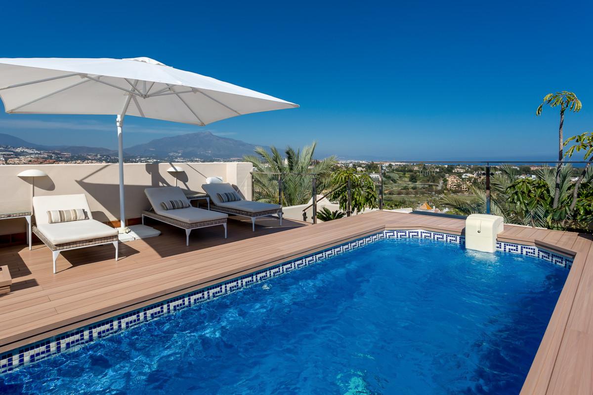 Stunning three bedroom penthouse apartment in prestigious El Paraiso Medio with spectacular sea, gol,Spain