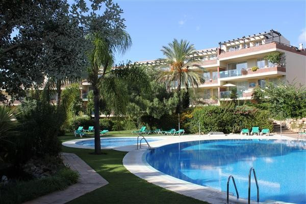 This bright, large 2 bedroom luxury, west facing ground floor apartment is situated within the exclu,Spain