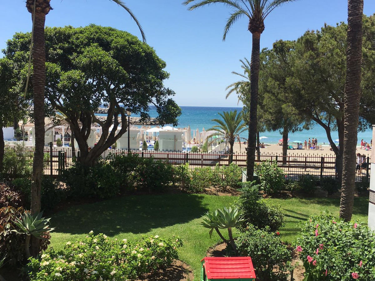 Spacious 3 bedrooms duplex apartment on the beach, in a private complex with pool and garden, securi,Spain