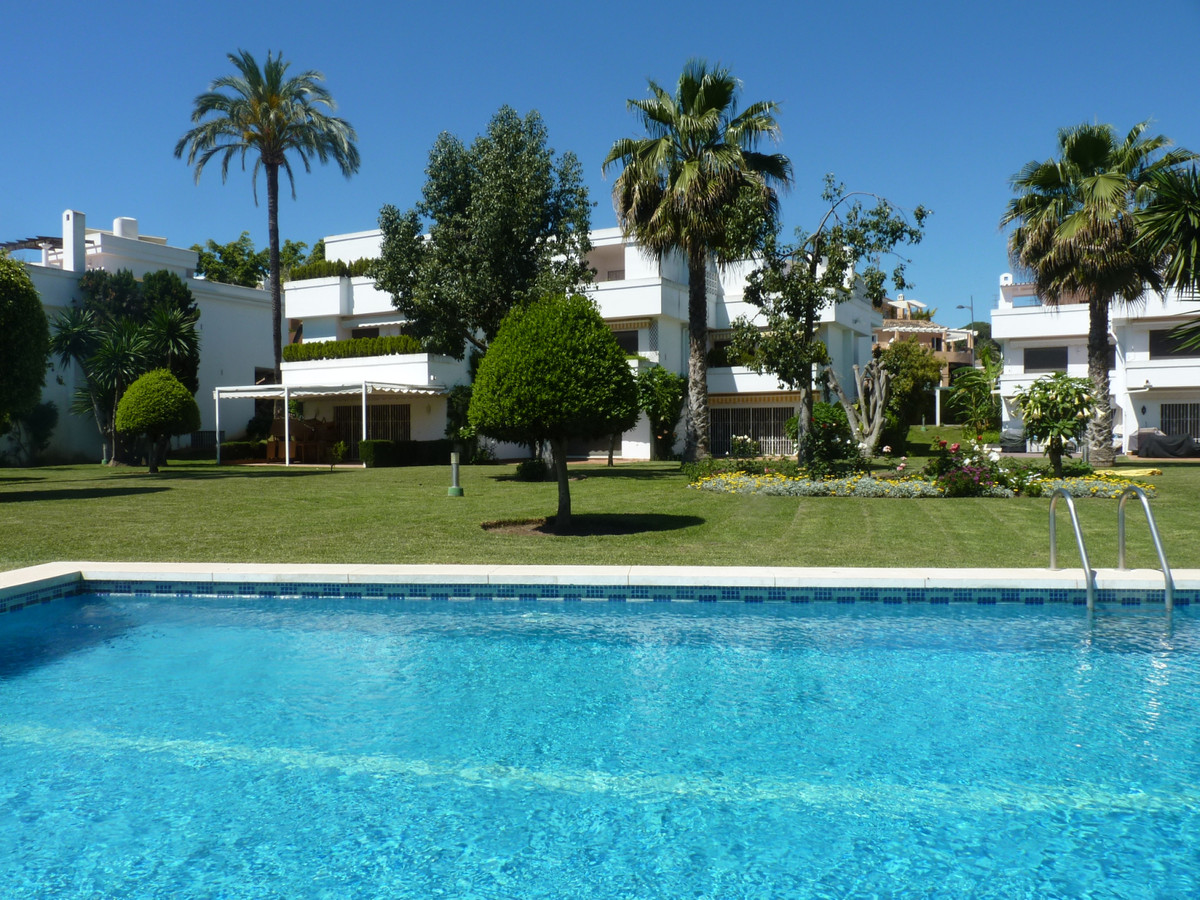 This is a lovely, large, corner townhouse situated in a small, beautifully maintained, gated garden ,Spain