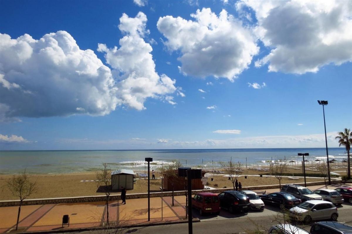 Front line beach apartment in the well known La Concha buiding on Los Boliches's promenade. Com,Spain