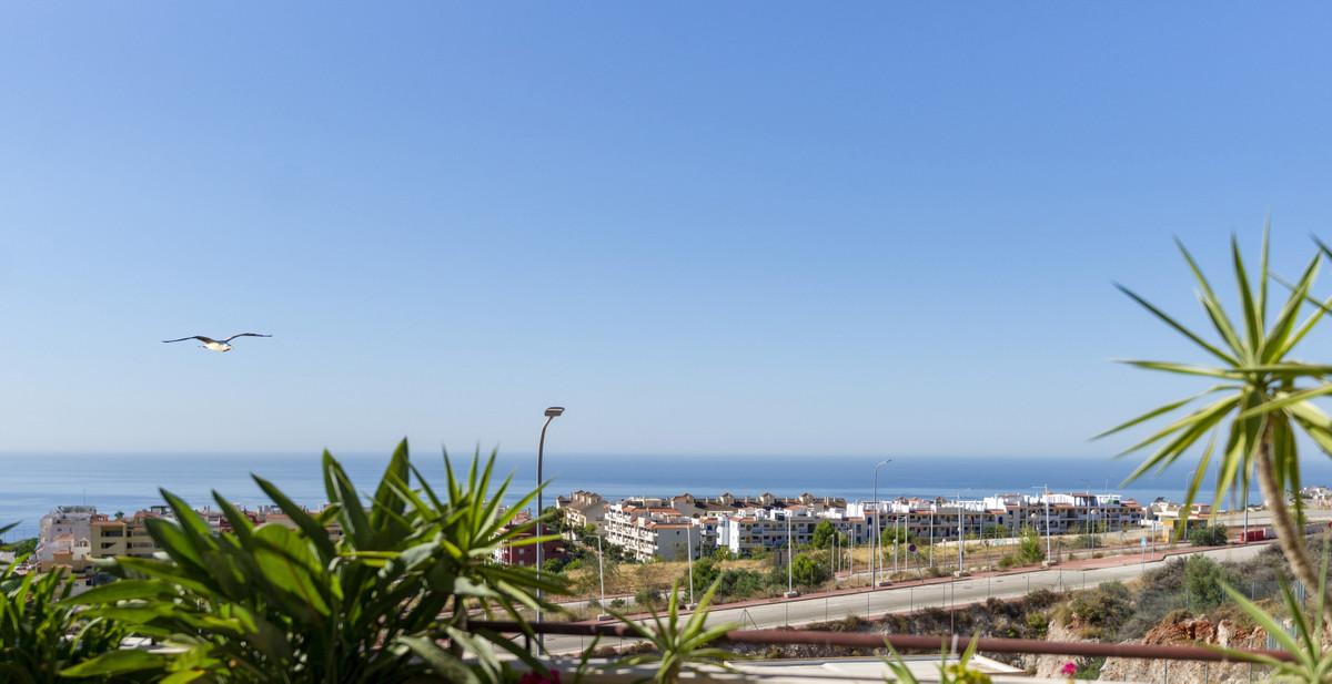Located on the hillside of Santangelo Norte overlooking Arroyo de la Miel this capacious elegantly a,Spain