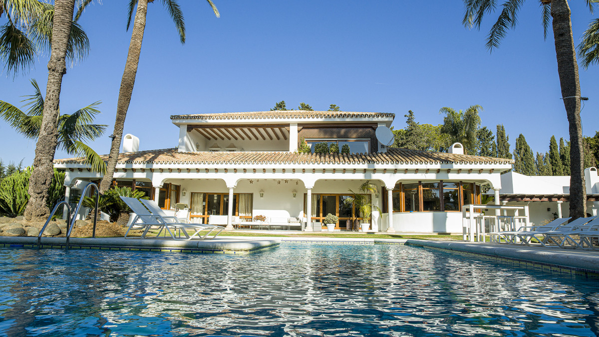 A great property on a large plot close to the beach and privately enclosed within mature gardens and,Spain