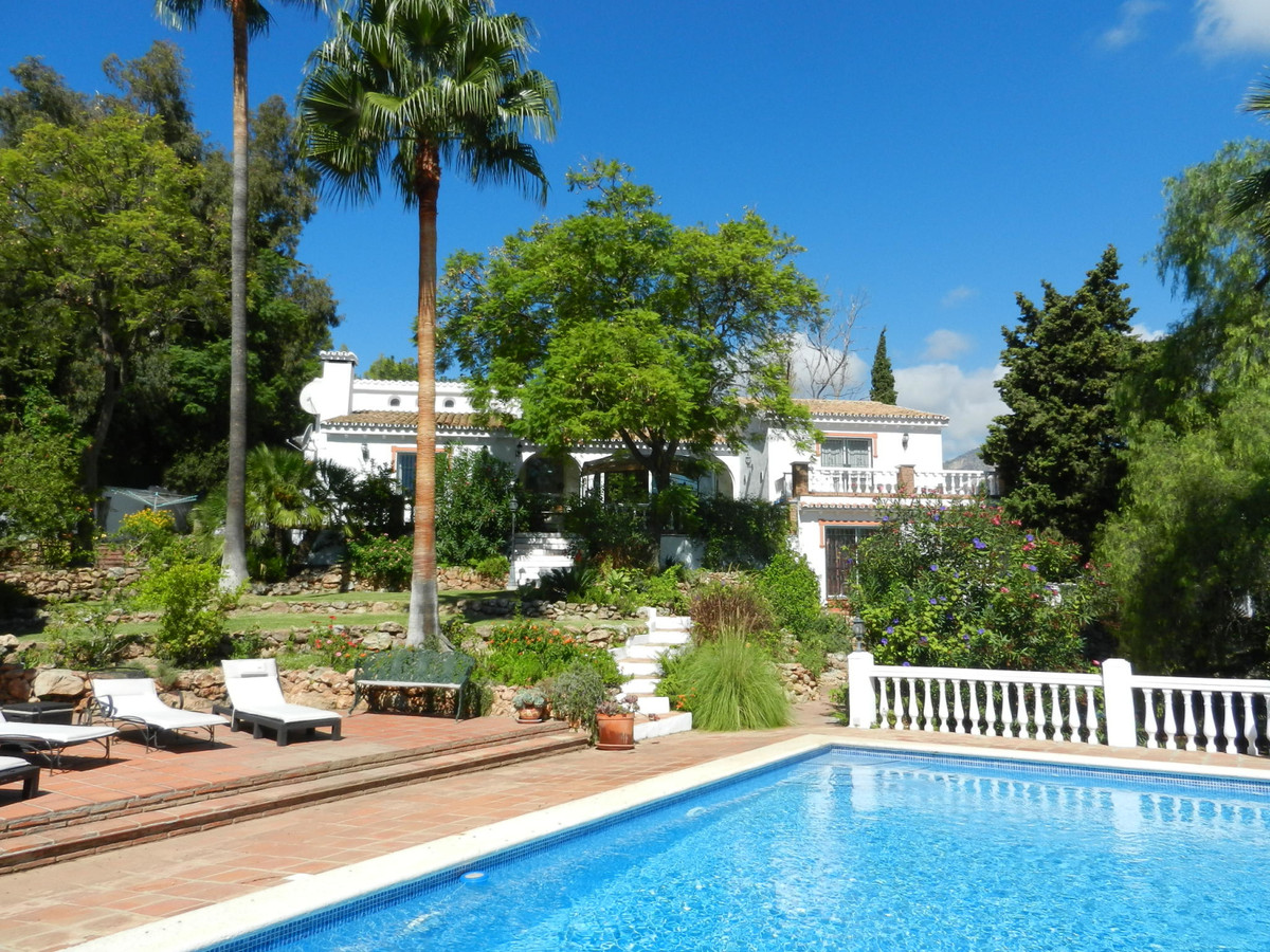 An impressive 5 bed villa is in a secluded area of Cortijos San Rafael, Frigiliana, set amongst a co,Spain