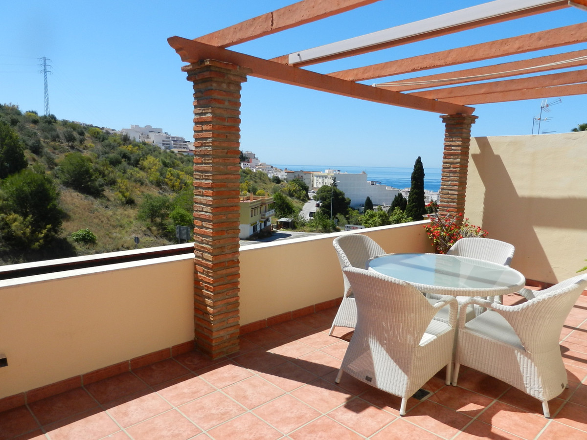 A spacious and well presented 3 bedroom townhouse with sea views close to beautiful bay of La Herrad,Spain
