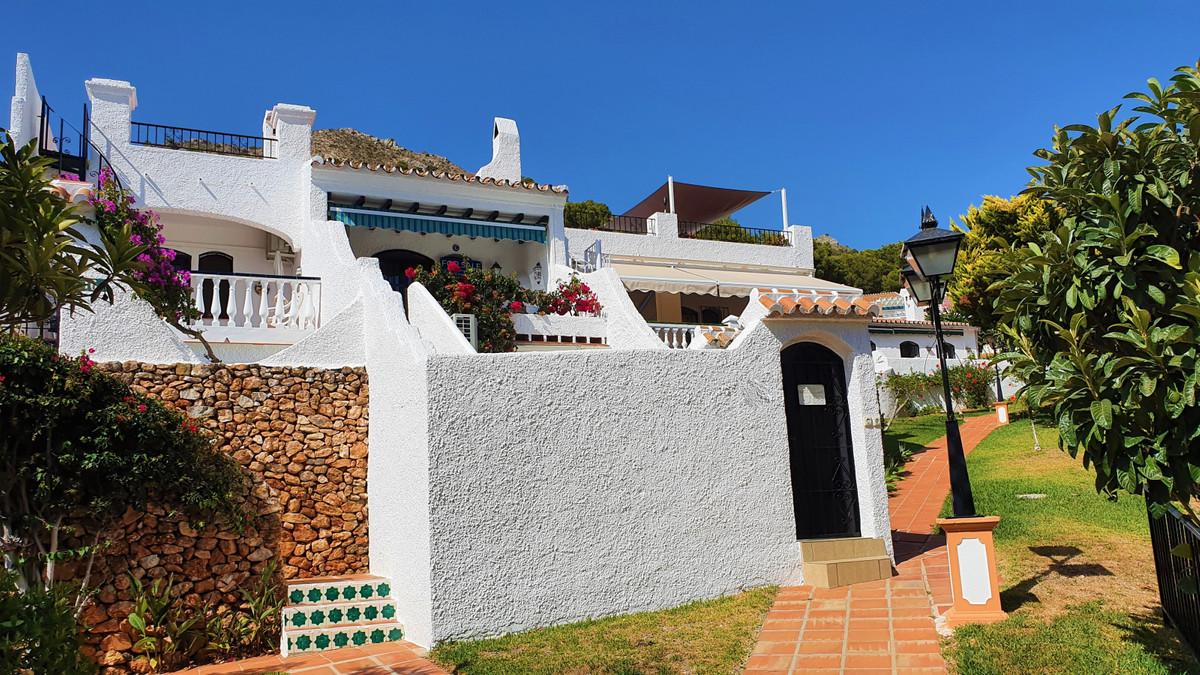 A 3 bedroom, 2 bathroom townhouse, south facing terrace with sea views & terraced garden in San ,Spain