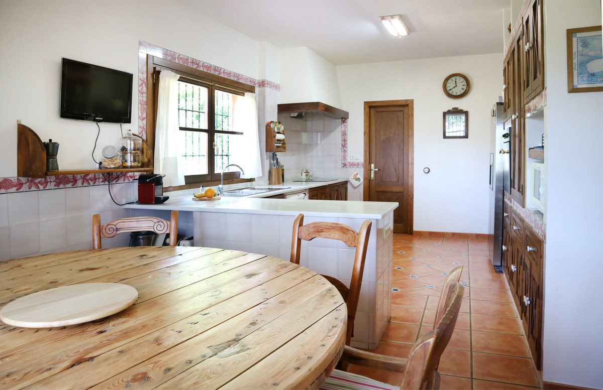 It has an attached house with 2 floors. Ground floor with 1 bedroom and 1 bathroom. Upper floor with,Spain