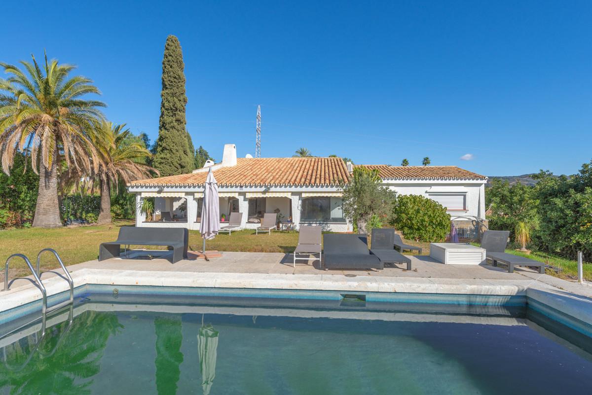 Villa for sale in El Rosario, Marbella with 5 bedrooms, 3 bathrooms and with orientation south/west,,Spain