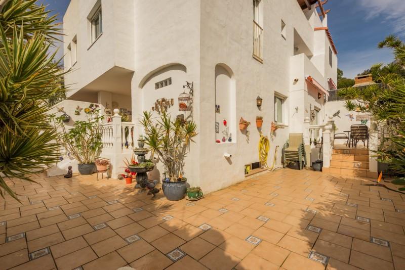 Town House for sale in Nagueles, Marbella Golden Mile, with 5 bedrooms, 3 bathrooms, 1 en suite bath,Spain