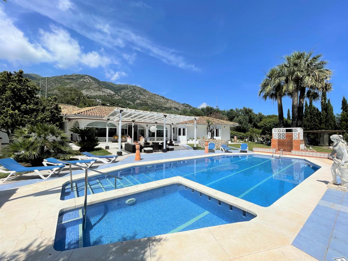 One level, 6 bed, 5 bath villa located on the prestigous La Alqueria urbanization just below Mijas v,Spain