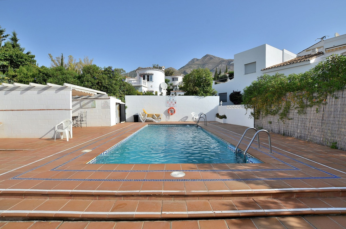 FULLY RENOVATED TOWNHOUSE WITH NICE OPEN VIEWS located in Arroyo de la Miel (Benalmadena), in a peac,Spain