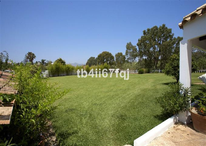 Beautiful villa with total privacy located frontline golf . This amazing property has 2 covered terr,Spain