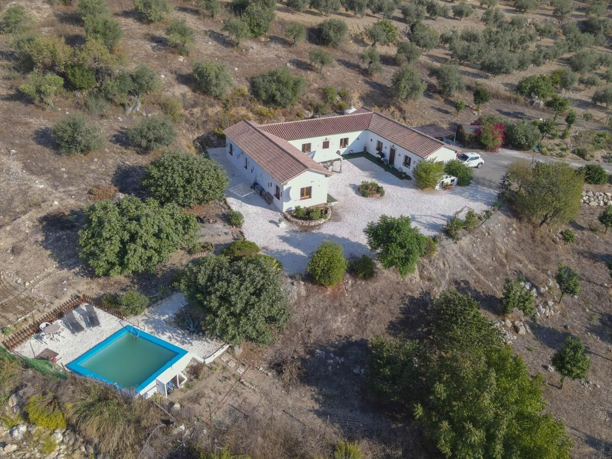 Beautiful cortijo style property nestled in the hills of Casarabonela.  This unique 'U' sh,Spain