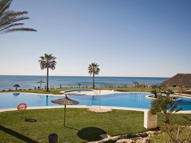 Frontline beach garden apartment in exclusive complex offering uninterrupted sea views.  Recently re,Spain