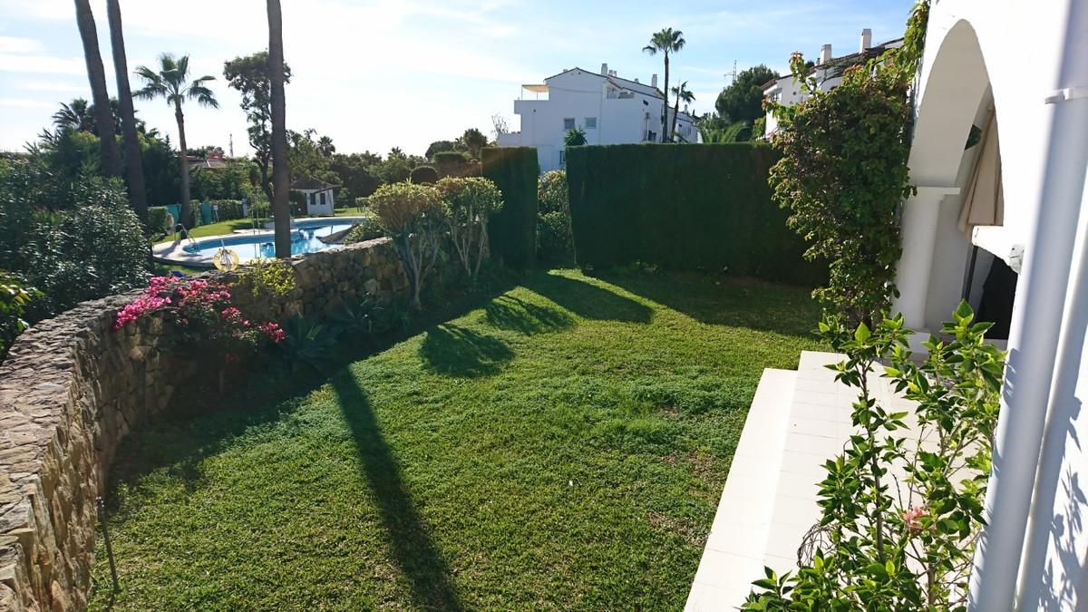 This is a cosy two bedroom ground floor corner apartment situated in Balcon de Benavista in El Parai,Spain