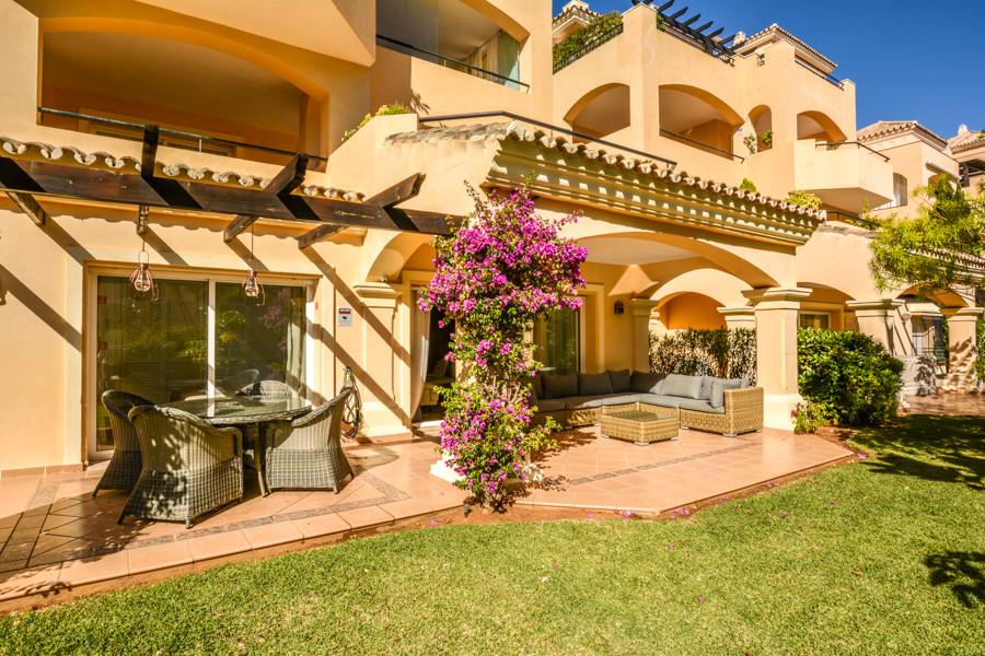Luxury corner ground floor garden apartment set in a much sought after residential development in El,Spain