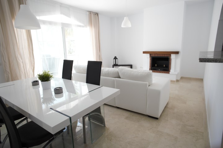 The apartment has 80 m2 with lateral sea views from the 14m2 terrace .  The apartment is South East ,Spain