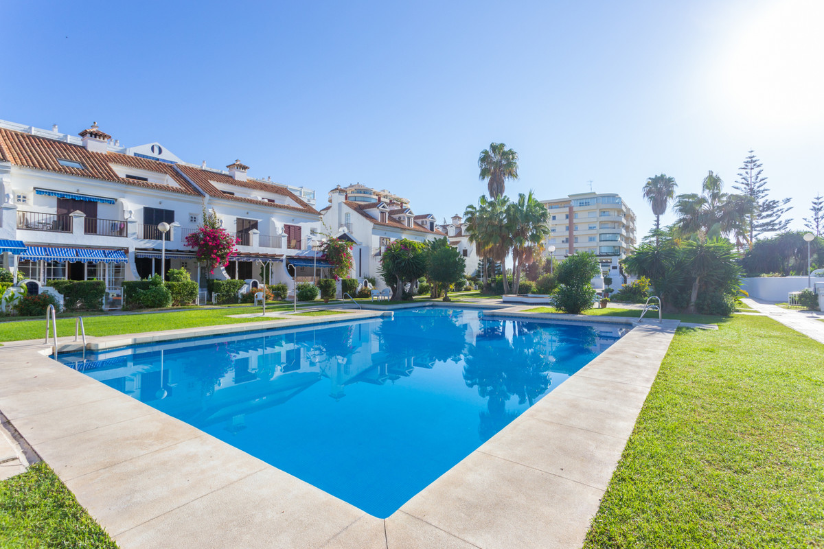 The townhouse located in a gated community within walking distance to the beach! It comprises of 3 s,Spain