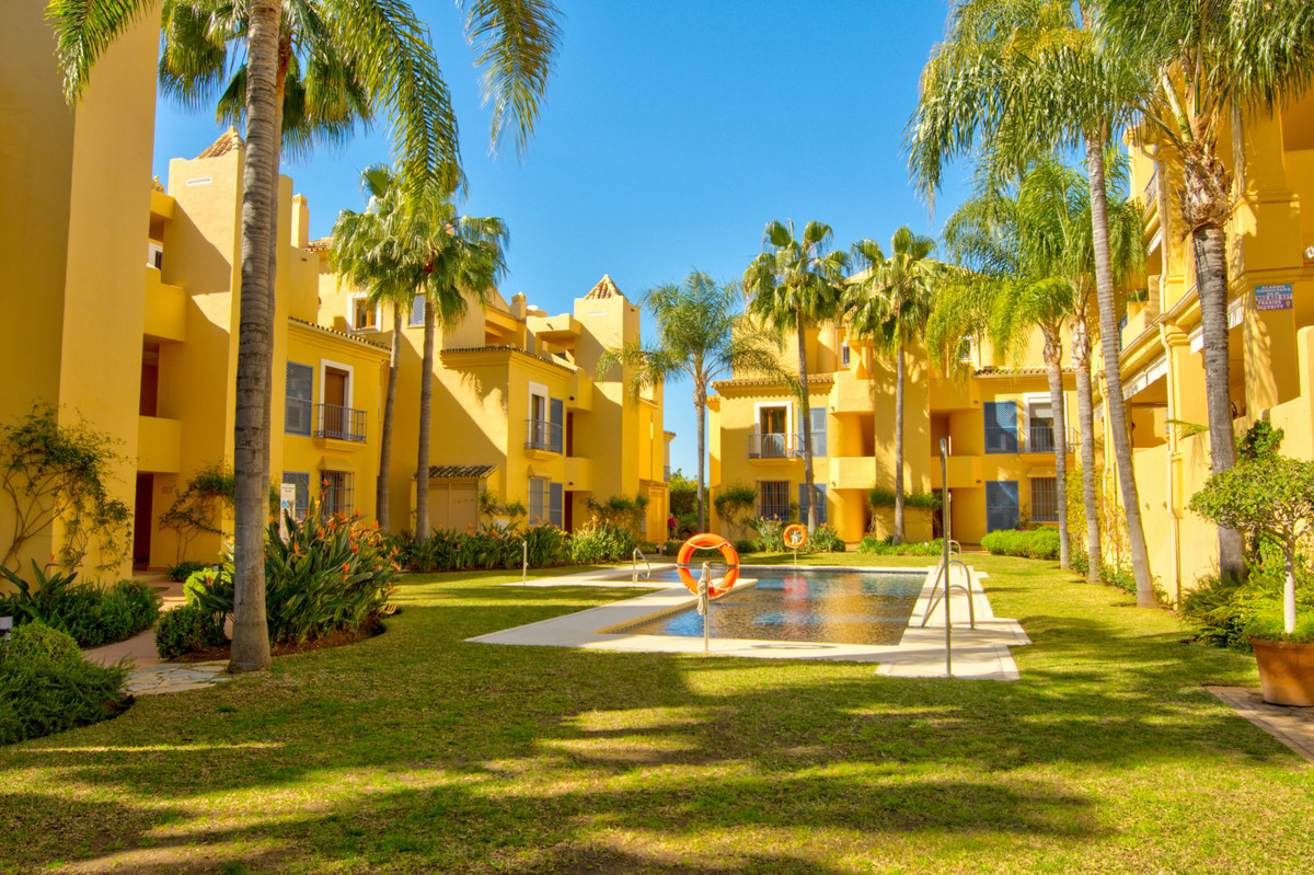 Wonderful 3 bedroom ground floor apartment located within the exclusive development in Nagueles. Loc,Spain