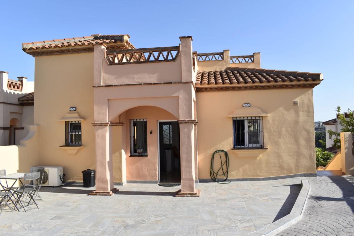 Semi-detached house in La Condesa de Mijas-Golf Urbanization. It has a large porch with an open gara,Spain