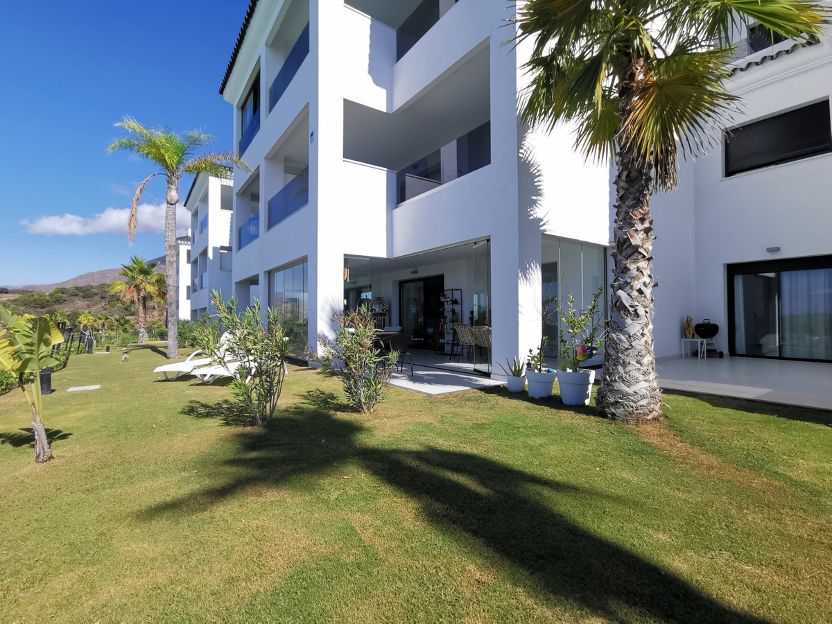 We suggest this apartment, in the Mirador de Estepona Hills Condominium, with three bedrooms, two en,Spain