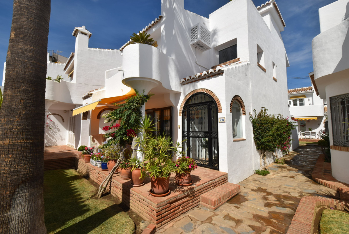 Beautifully presented, bespoke two bedroom townhouse in the much sought after Mijas Playa Club.  Wel,Spain